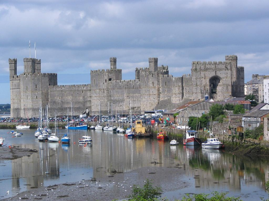 Caernarfon Castle - Minibus sightseeing tours. Private hire. Wales.